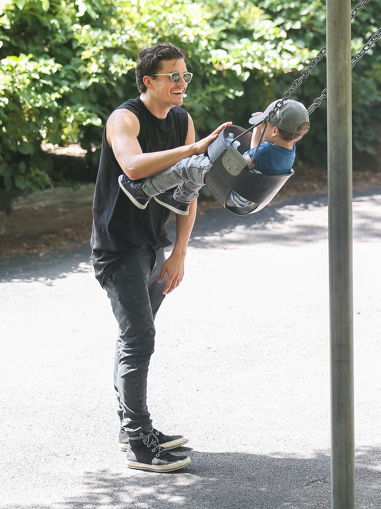 Orlando pushed Flynn on a swing in Central Park, NYC, in July 2013.