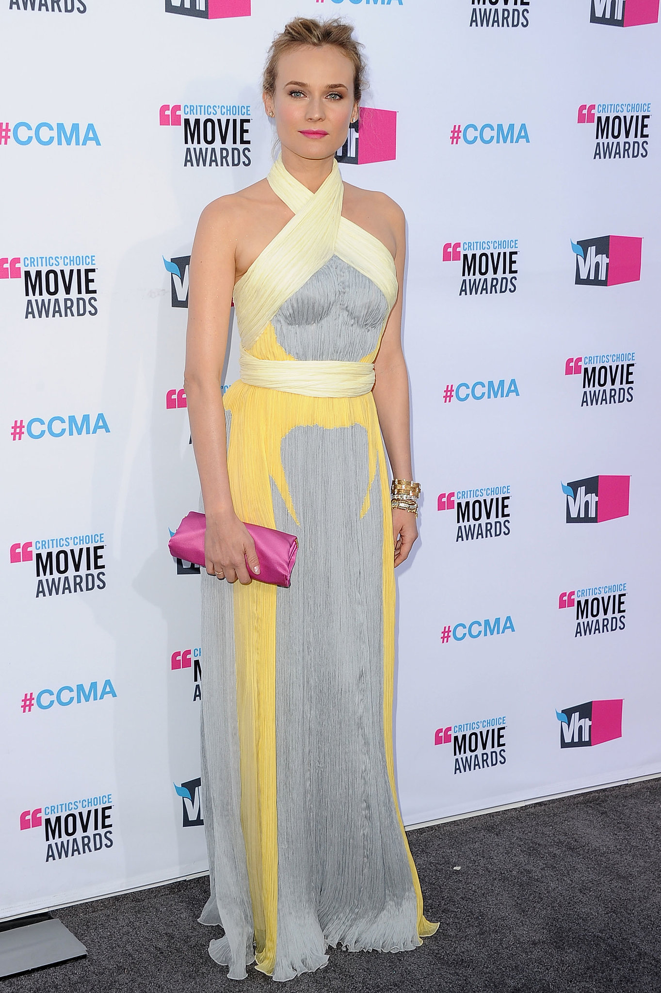 Diane Kruger wowed in a Prada Spring '12 halter gown decked out in a melange of pastel grays, lemon, and canary yellows at the 2012 Critics' Choice Awards. She contrasted these hues with a hot-pink clutch to give her look an extra colorful boost.