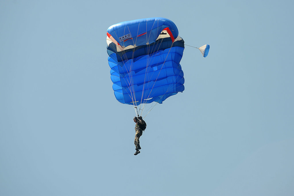 A parachutist landed during the Bastille Day parade in Paris.