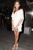 Olivia Palermo toasted to Girl Most Likely at the afterparty for the screening in a cool white look.