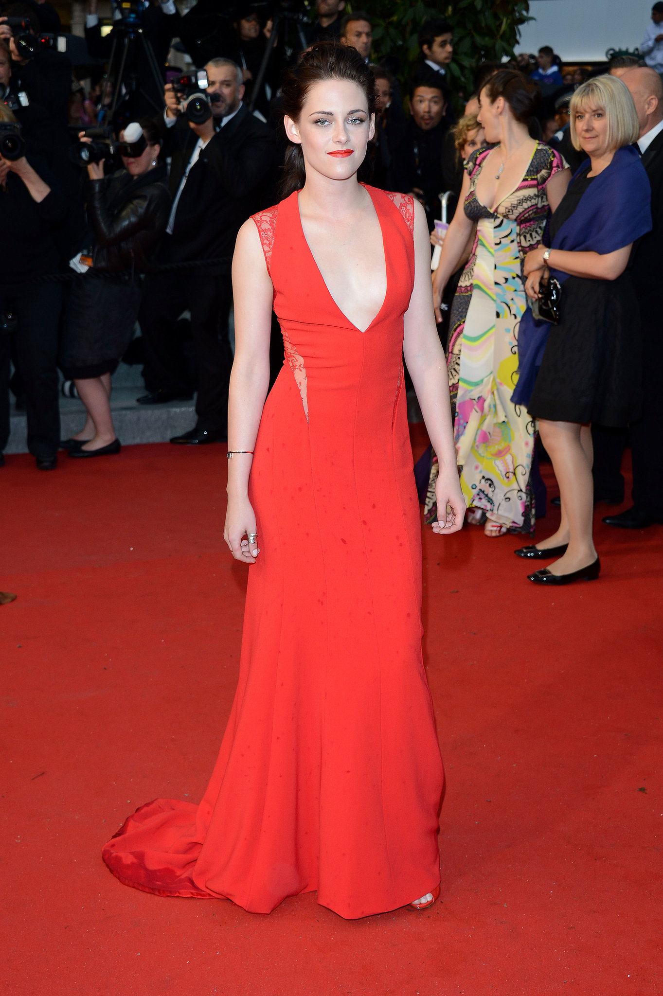 Stewart looked red hot in a fitted Reem Acra gown with a deep V neckline at the Cannes Film Festival premiere of Cosmopolis in late May 2012.