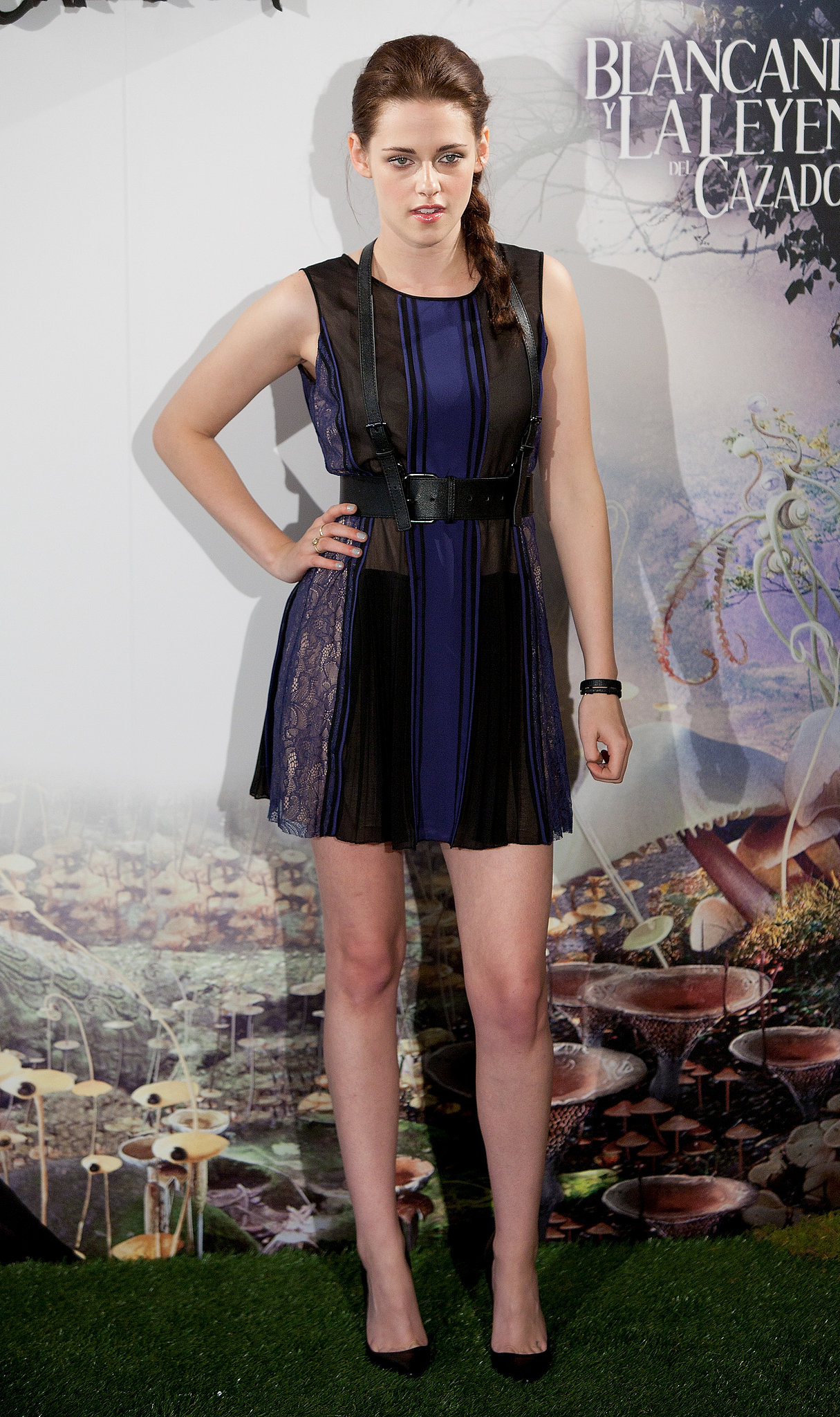 Stewart married black and blue in a lace-paneled, fit-and-flare dress for the Madrid photocall of Snow White and the Huntsman in May 2012.