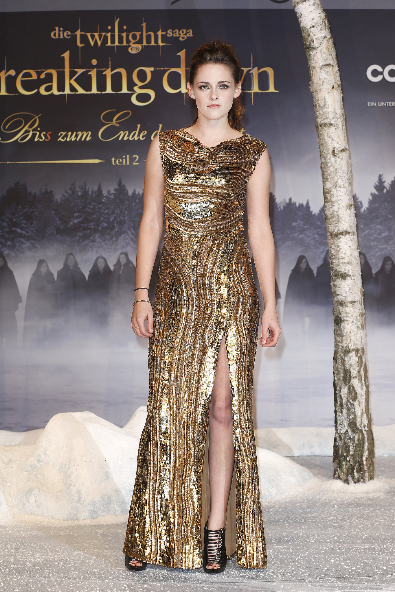 We couldn't get enough of the embellished gold Elie Saab gown that Stewart wore at the Germany premiere of Breaking Dawn Part 2 in November 2012. She showed off a pair of Christian Louboutin cage heels — and lots of leg — thanks to the gown's thigh-high slit.