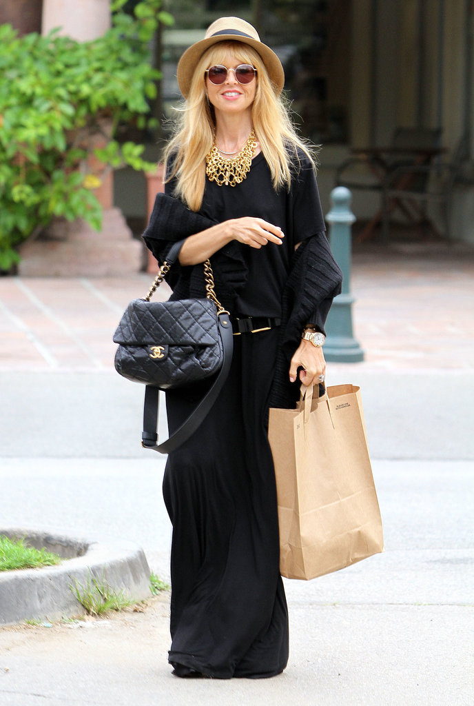 During another daytime outing, Rachel stuck to all black in a casual maxi dress, a quilted Chanel bag, fedora, round sunglasses, and another gold statement necklace.