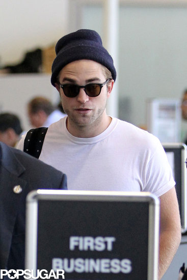 Exclusive: Robert Pattinson Smolders His Way Through Airport Security