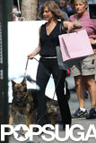 Jennifer Aniston walked a dog on the Squirrels to the Nuts set.
