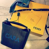 The best perk to modeling for Fendi: custom totes! Source: Instagram user caradelevingne