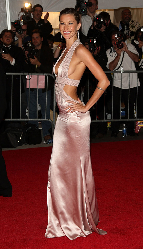 Jaws dropped when Gisele stepped out in a show-stopping soft pink satin Versace number at the 2008 Met Gala. The model showed off her flawless figure with sultry cutouts that left little to the imagination.