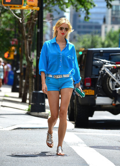 Karolina Kurkova stuck to blue in a button-down blouse and mini denim shorts while out in NYC.