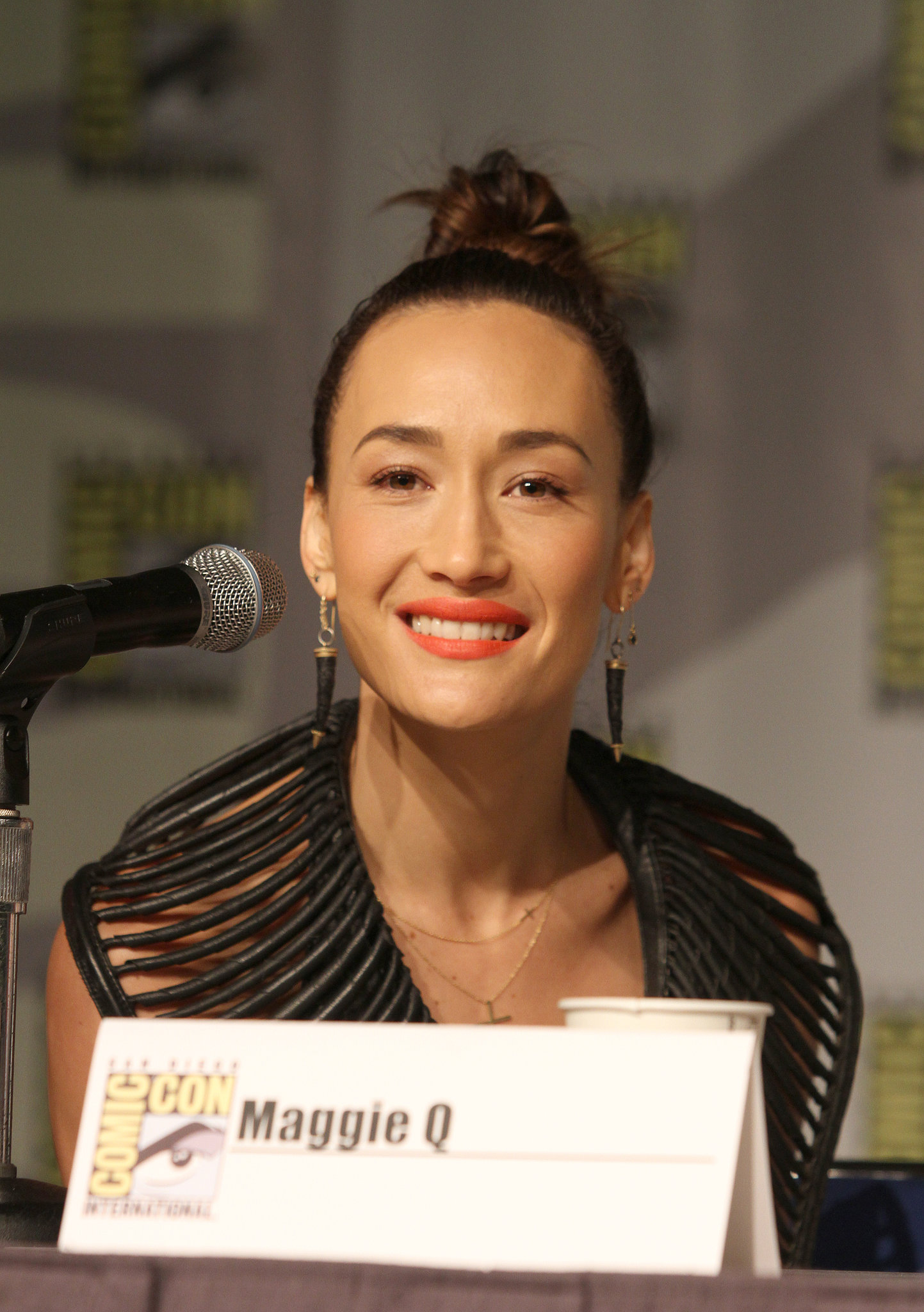 Maggie Q paired a tangerine lip with a cheeky topknot on the panel for Nikita.