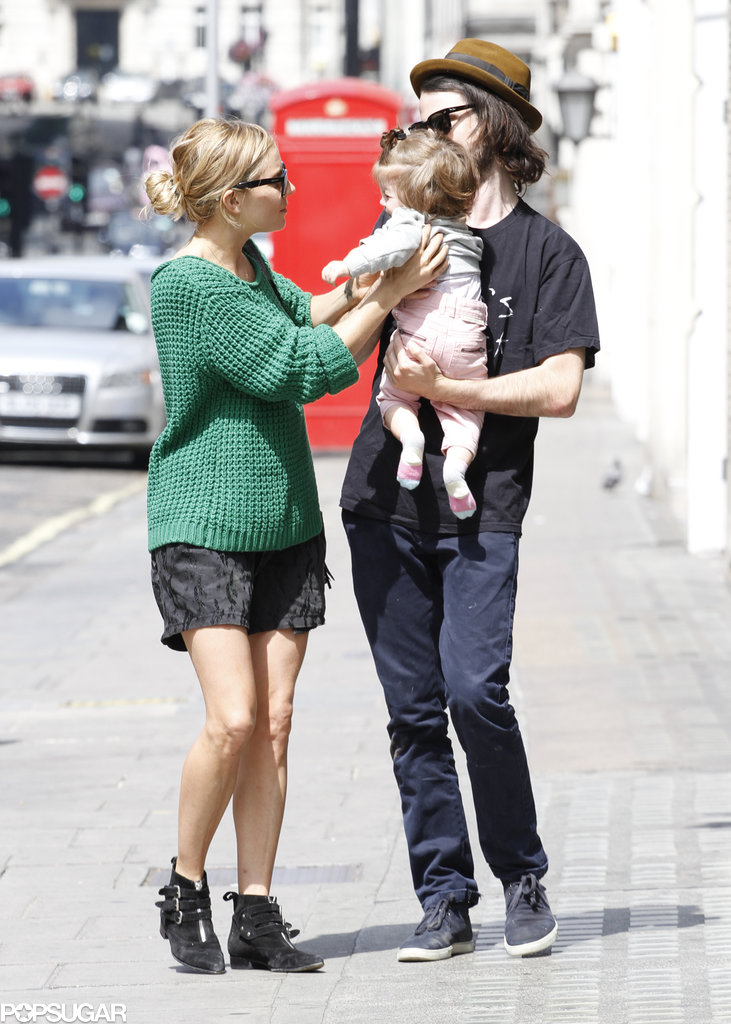Sienna Miller handed her daughter, Marlowe, to Tom Sturridge.