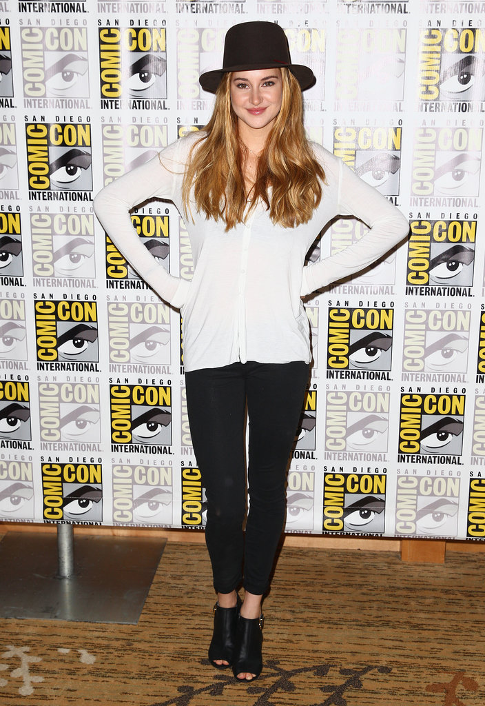 Shailene Woodley wore a wide-brimmed black hat, a white cardigan, and black trousers to a press event for the movie Divergent.