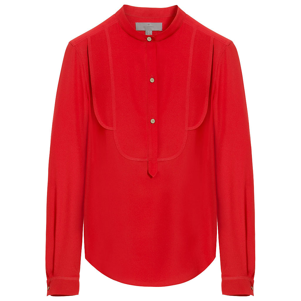 To break up the dress parade, we could see her in this siren-red silk top ($950) from Mulberry.