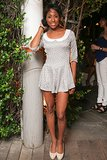 A girlie romper got party-ready with the addition of sky-high pumps.  Source: David X Prutting/BFAnyc.com