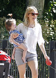 Sienna Miller laughed while holding onto Marlowe.