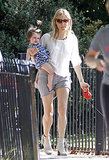 Sienna Miller carried Marlowe through a park.