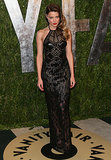Amber stuck to another sheer, sparkly, and sexy number at the 2013 Vanity Fair Oscar party. Her red lips and nails were the perfect pops of color.