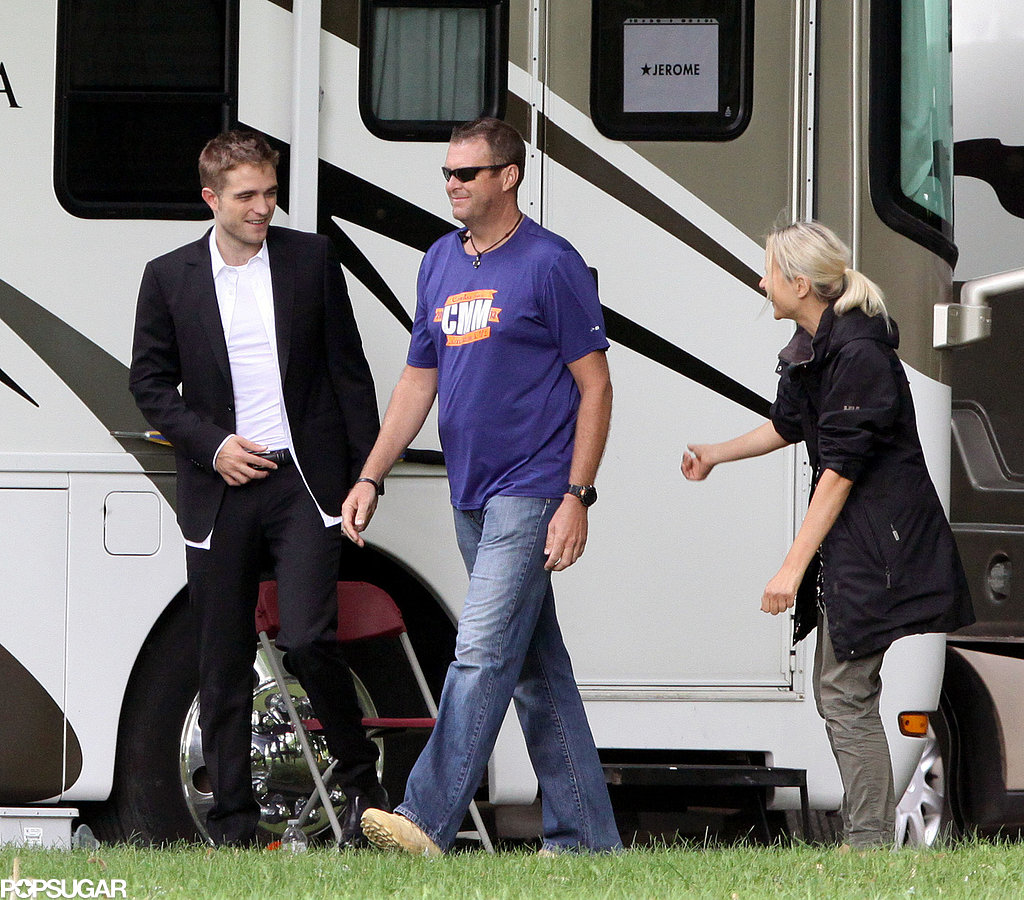 Robert Pattinson smiled on his Toronto set.