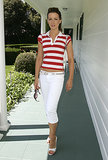 Topping her shortened white denim with a red striped polo, Kate's patriotic look was perfect for the Juicy Couture Swimwear launch in July 2004.