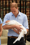 Prince William looked down at his newborn son as they left the hospital.