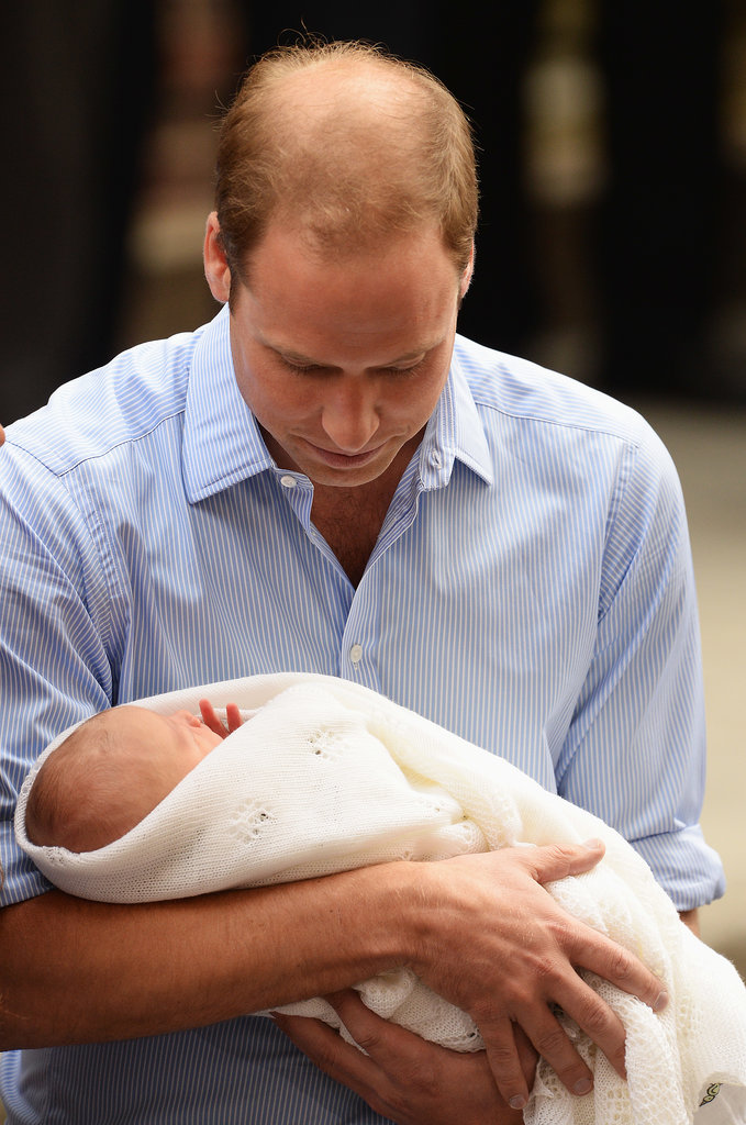 Prince William held his firstborn as they left the hospital in London.