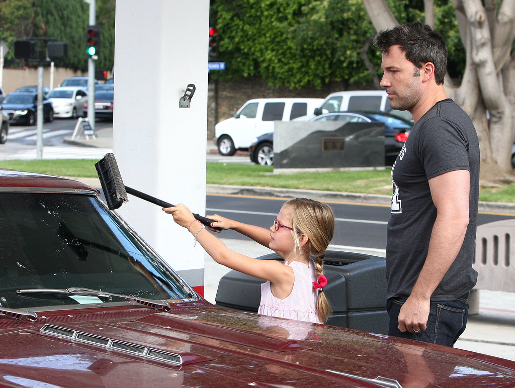 Violet helped Ben Affleck clean his windshield.