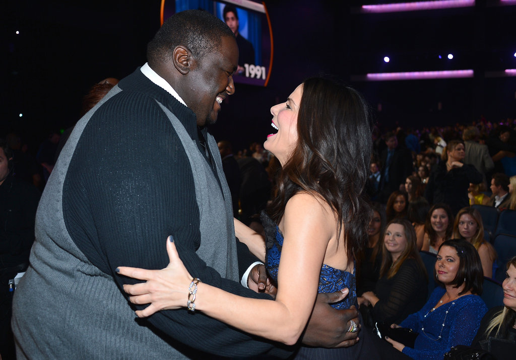 She shared a laugh with her The Blind Side costar Quintin Aaron at the People's Choice Awards in January 2013.