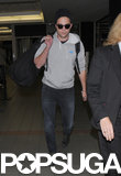 Robert Pattinson carried a large duffel bag.