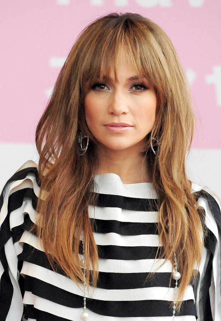 While Jennifer (pictured at a Tokyo event in 2009) usually goes bang-free, fringe looks fabulous on her.