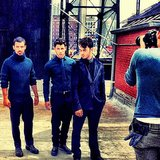 Kevin, Nick, and Joe Jonas struck sultry poses on the set of a Fault  magazine shoot. Source: Instagram user adamjosephj