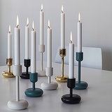 These metallic (our favorite) or  powder-coated steel candle holders ($79) look great mixed or matched.