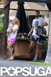 Shakira held onto son Milan while Gerard Piqué followed with a car seat.