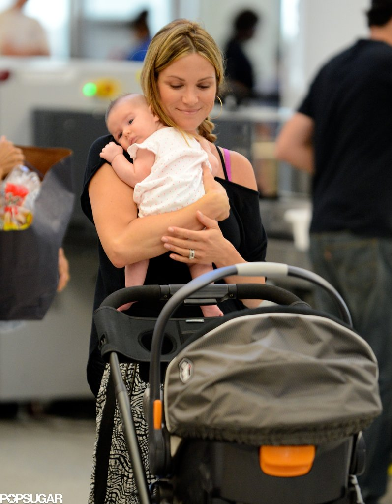 Danneel Harris smiled while holding her new baby daughter.