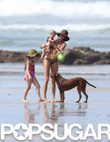 Gisele Bündchen played with a friend's dog on the beach.