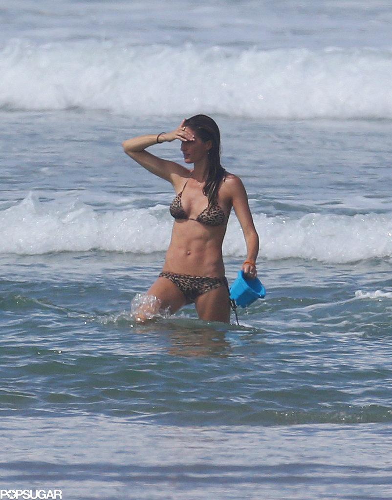 Bikini-Clad Gisele Clings to Baby Vivian on the Beach!