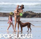 Gisele Bündchen held on to her daughter, Vivian Brady, on the beach.