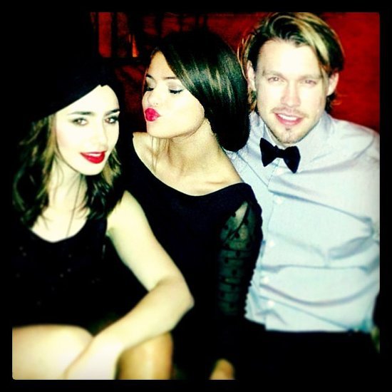 Selena Gomez and Lily Collins looked darling in bold brows and bright lips posing with Chord Overstreet. Source: Instagram user selenagomez