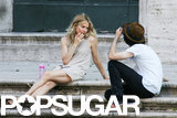 Sienna Miller and Tom Sturridge chatted in front of a building.