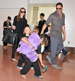 Angelina Jolie and Brad Pitt strolled through the Tokyo airport with their brood in July 2013.