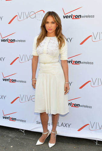 Jennifer Lopez paired a ladylike white lace Elie Saab dress with white ankle-strap pumps at the Viva Movil store opening in NYC.