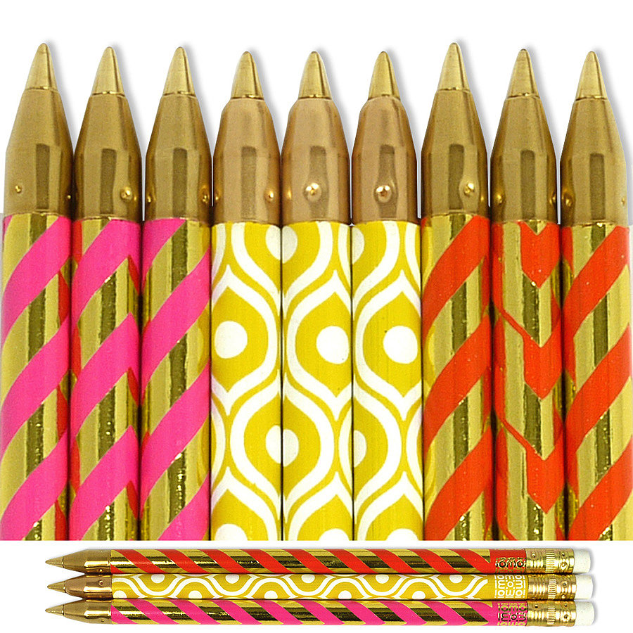 Fill a pencil cup with these Pink and Orange Chevron and Yellow Swirl Pens ($28 for 14) to add a vibrant punch to your desk top.