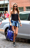 Miranda Kerr worked denim cutoffs with a black tank, studded Chloé booties, and a blue studded Valentino bag in NYC. We love that she tied a denim shirt over her shorts for a nod to the grunge trend.