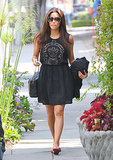 Eva Longoria was feminine in a little black eyelet dress and pink flip-flops after leaving the hair salon in LA.