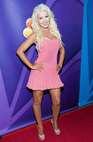 Christina Aguilera showed off a bright pink minidress on the red carpet at NBC's TCA tour.