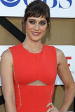 Lizzy Caplan wore a dazzling orange dress to the Summer TCA Press Tour party.