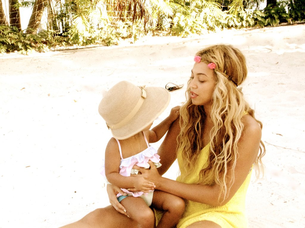 Beyoncé Knowles kept daughter Blue Ivy entertained on the beach wearing a floral garland. We're loving baby Blue's hat, too.  Source: Tumblr user Beyoncé