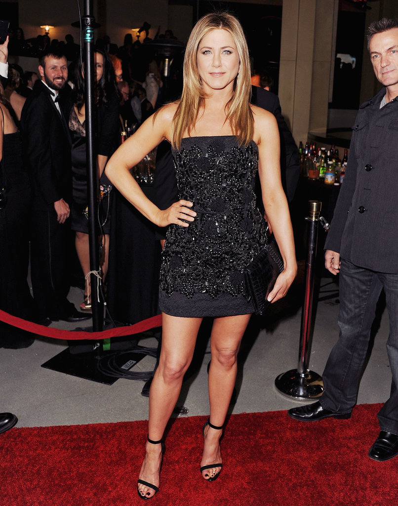 Jennifer Aniston sported her signature red carpet look — embellished LBD by Dolce & Gabbana, coordinating ankle-strap sandals, and sleek locks — for the DGA Awards in January 2012.