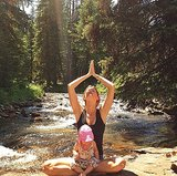 Supermodel Gisele Bündchen saluted the sun with her daughter, Vivian.  Source: Instagram user giseleofficial