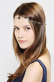 A delicate headband, like the Urban Outfitters Filigree Headwrap ($14), is a great way to add a touch of glitz while still being trendy.
