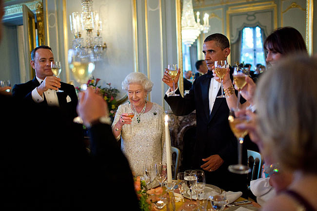 Tom Hanks raised his glass alongside Queen Elizabeth II and President Obama at Winfield House in London in May 2011. Source: Flickr user The White House